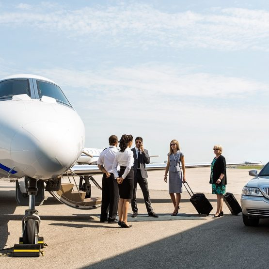 men and women getting on their private jet flight